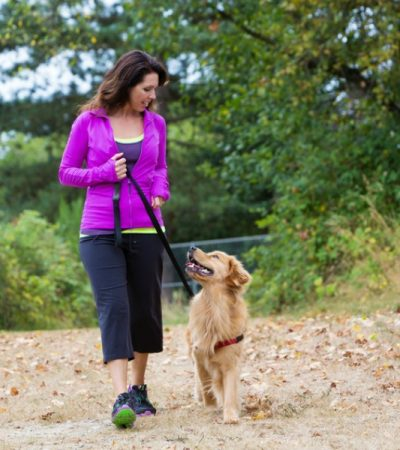 lady walking the dog to reduce menopause symptoms
