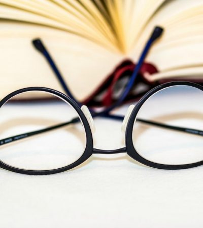 eye glasses in front of a book