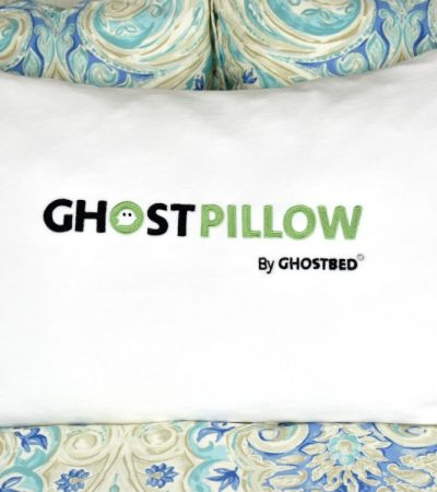 GhostPillow faux down pillow on bed