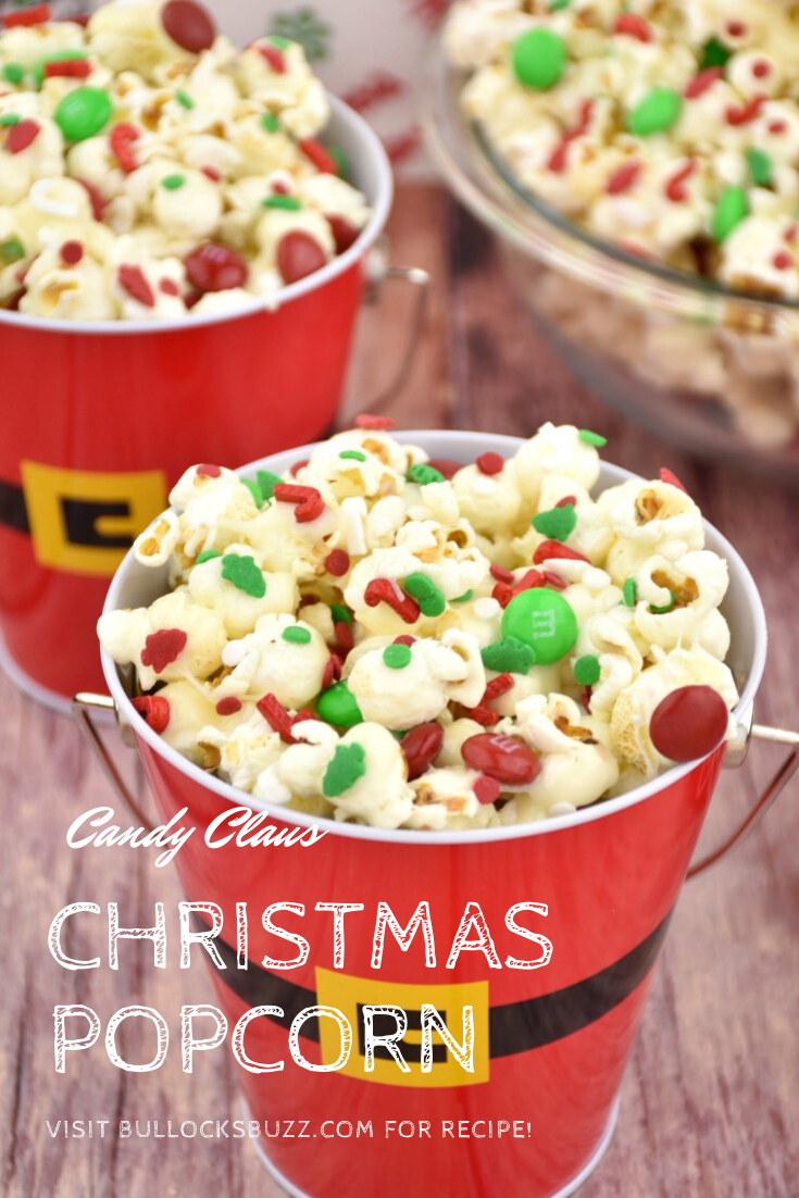Salty and sweet popcorn sprinkled with a festive mix of M&Ms and Christmas sprinkles, this delicious Candy Claus Christmas Popcorn is fun and festive treat that's quick and easy-to-make! #recipe #Christmas #hoildayrecipe #Christmastreat