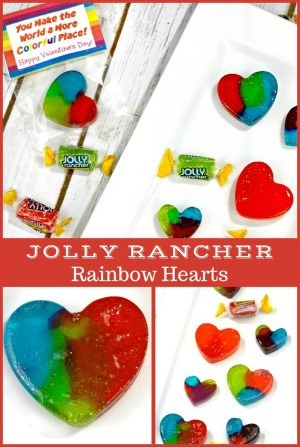 These heart-shaped homemade Jolly Rancher Rainbow Hearts are the perfect gift for Valentine's Day. Free printable tag!