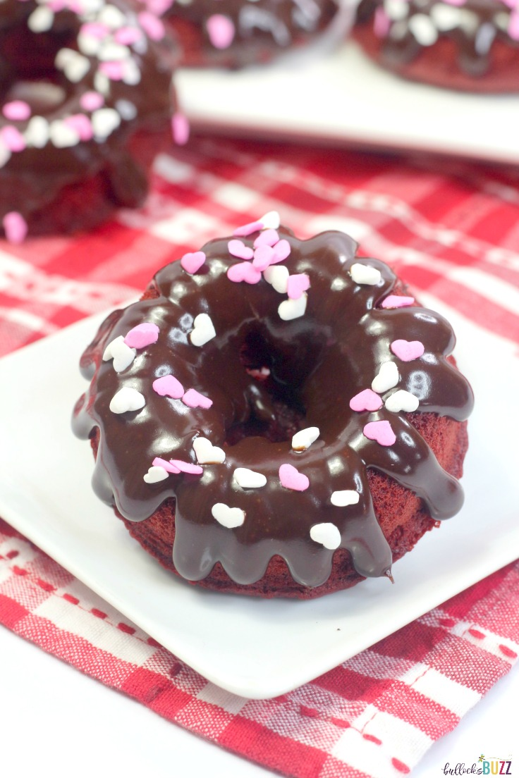 These soft and moist Red Velvet Donuts are topped with a scrumptious chocolate ganache glaze that makes them absolutely delicious!