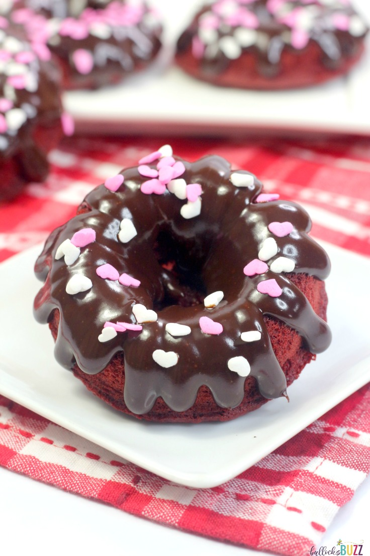 The vibrant red color and delectable chocolate flavor make these baked red velvet donuts the perfect Valentine's Day treat for your special someone!