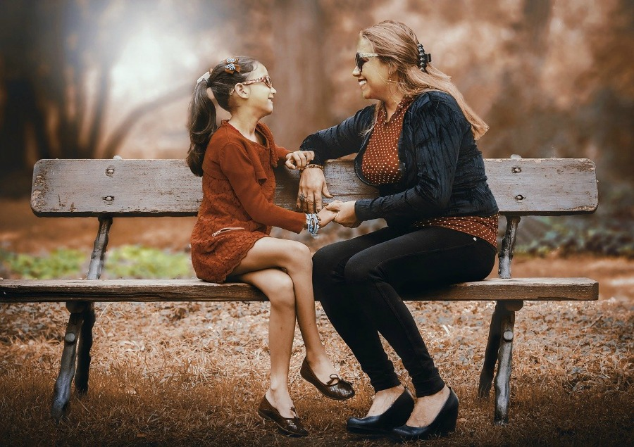 mother and daughter talking can help build a healthy relationship with your child