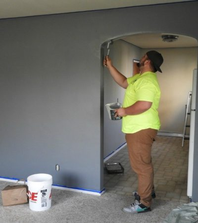 DIY such as painting the walls yourself is an easy way to how to renovate your home affordably