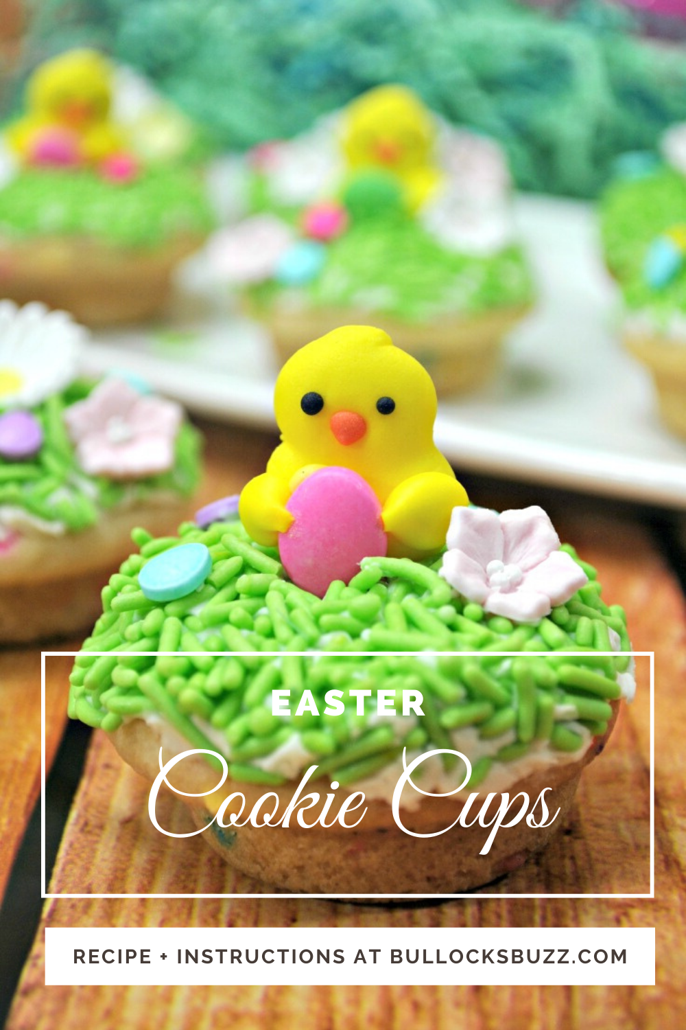 Deliciously sweet sugar cookie cups are filled with a homemade vanilla frosting and topped off with candy grass, candy eggs, and a cute little Easter chick in this easy Easter Cookie Cups recipe. These sugar cookie cups are SO simple and make the perfect Easter dessert! #Easter #Easterrecipes #cookiecups