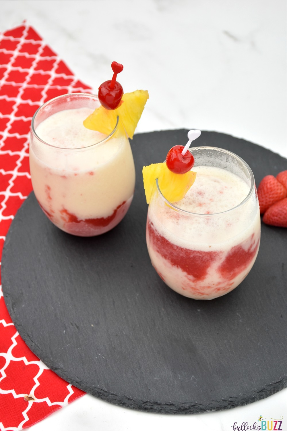 Garnished with a slice of pineapple and a cherry, this Lava Flow cocktail is the perfect summer drink! #cocktail #lavaflowcocktail