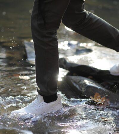 walking through water in loom sneakers