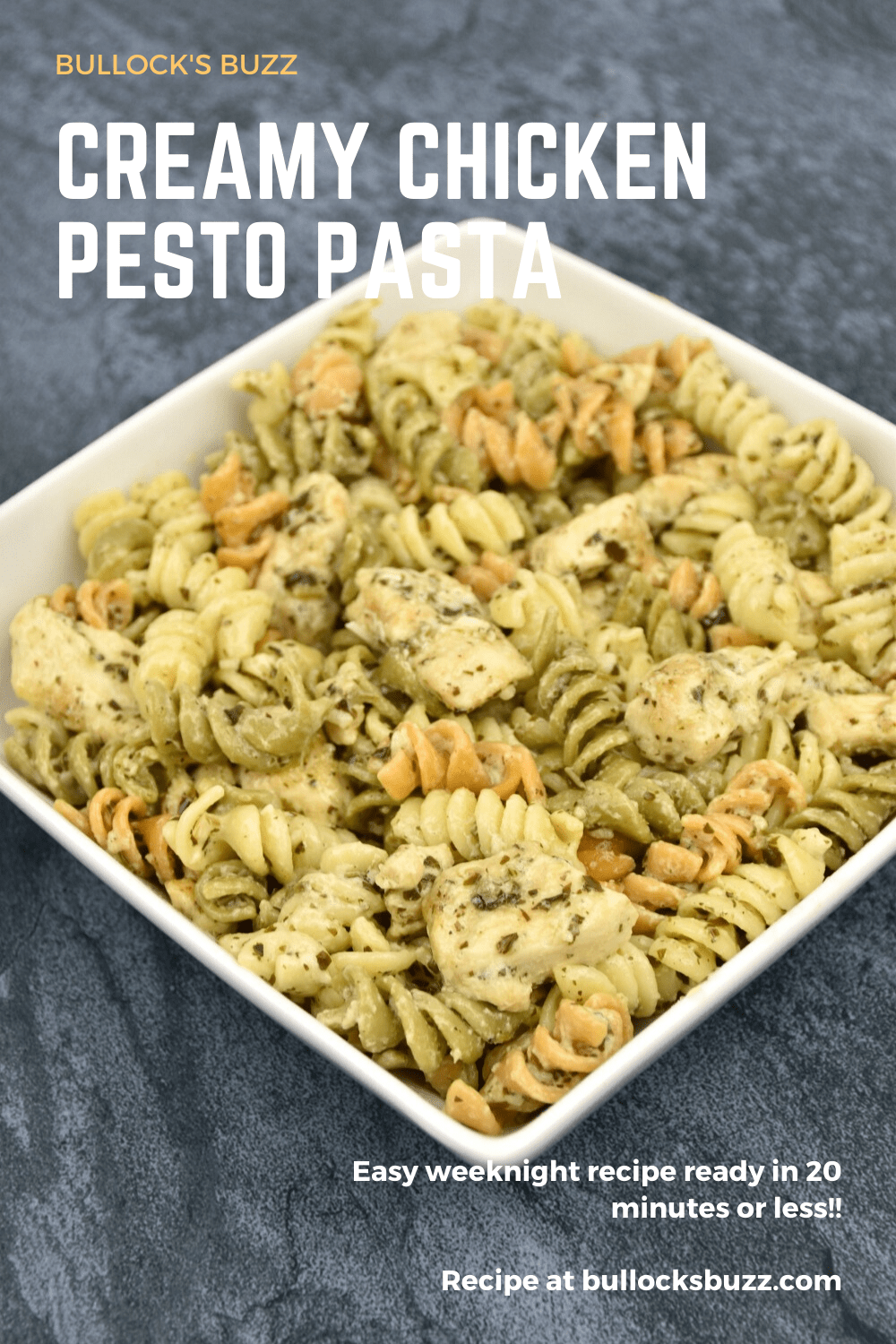Tender chicken and rotini pasta are smothered in a delectable pesto sauce and topped with Parmesan cheese in this quick and easy Creamy Chicken Pesto Pasta recipe.