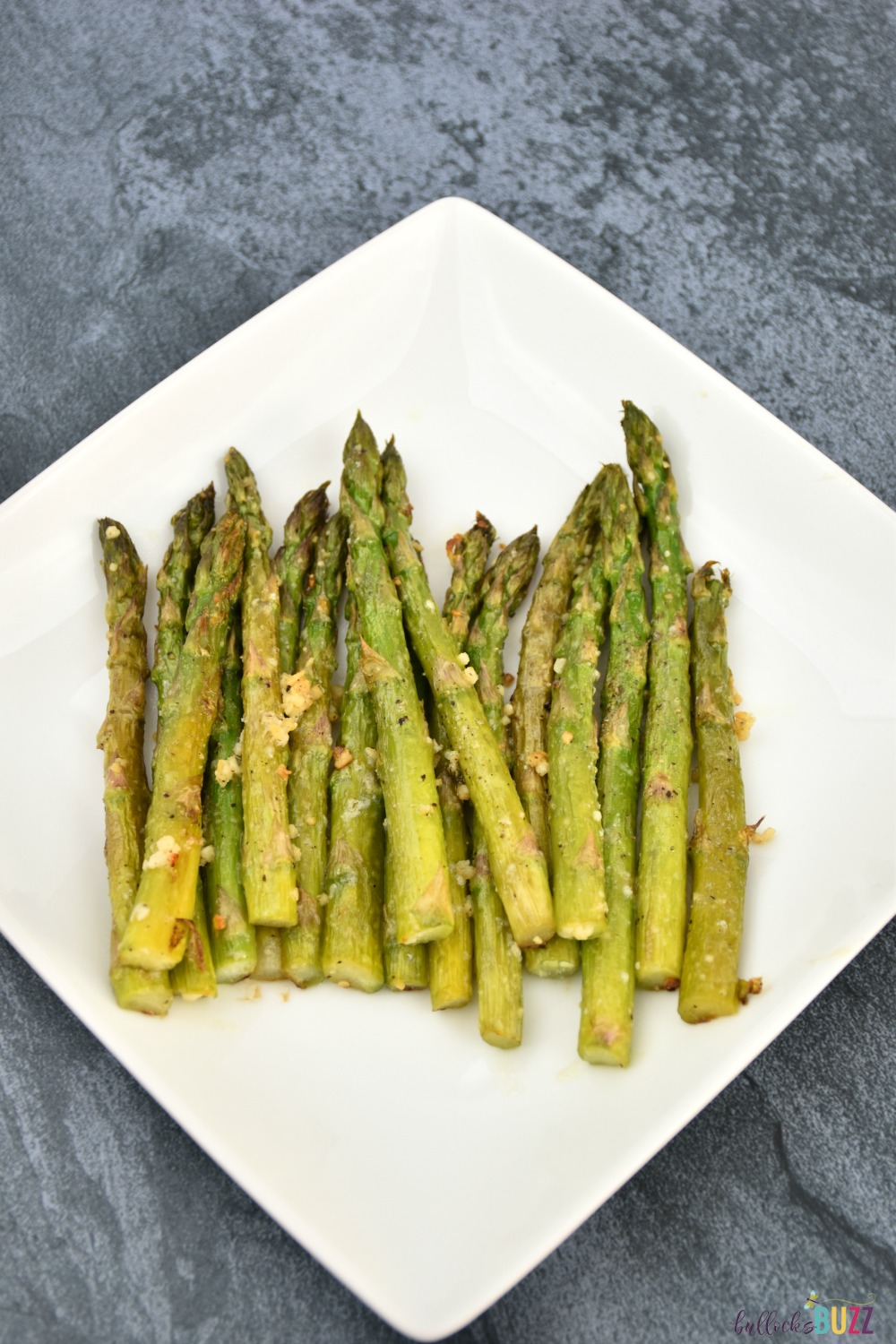 Tender spears of asparagus are seasoned and roasted to perfection in this quick and easy Oven Roasted Asparagus recipe.
