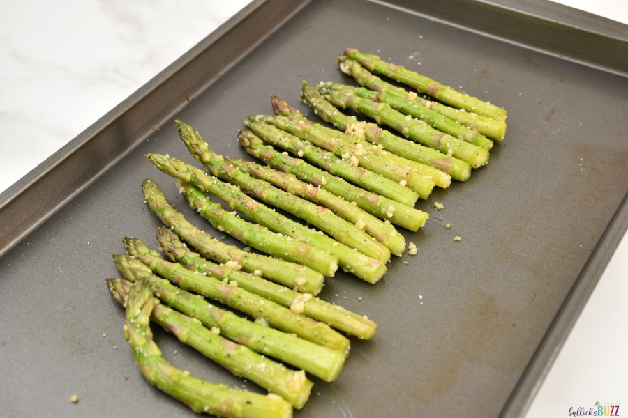 lay asparagus in a line on a baking sheet