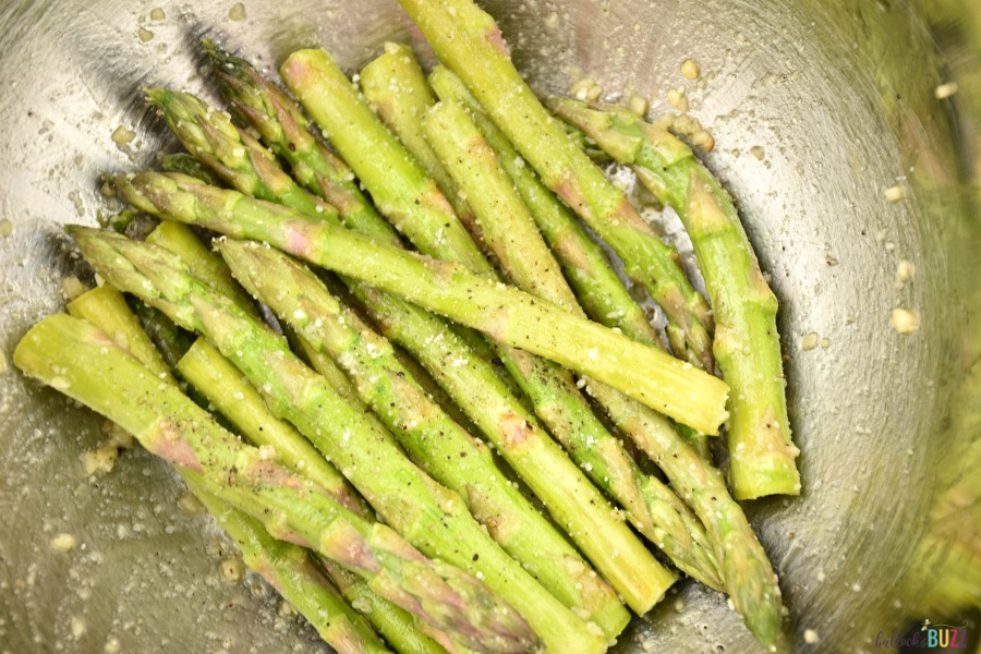 toss asparagus with olive oil and seasonings in a large bowl