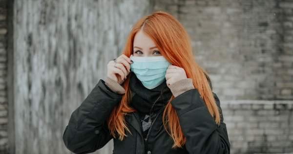 woman wearing a mask and COVID-19 and the Role Social Distancing Plays on Our Health