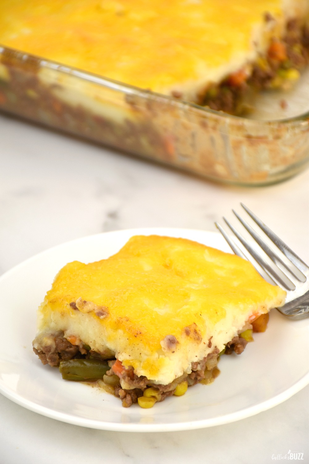 Made with seasoned ground beef, mixed vegetables, fluffy mashed potatoes and cheddar cheese, this Shepherd's Pie recipe is the ultimate comfort food.
