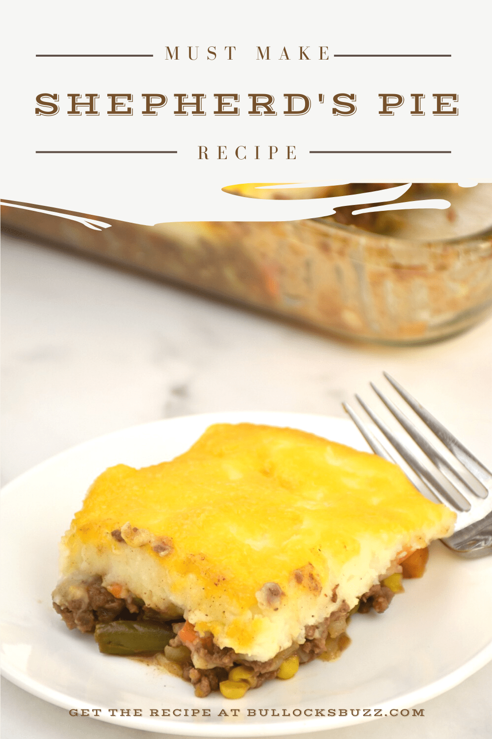 Seasoned ground beef and mixed vegetables are sauteed in a rich gravy, layered in a dish with creamy mashed potatoes, then topped with a layer of cheddar cheese before being baked to perfection in this easy Shepherd's Pie recipe.
