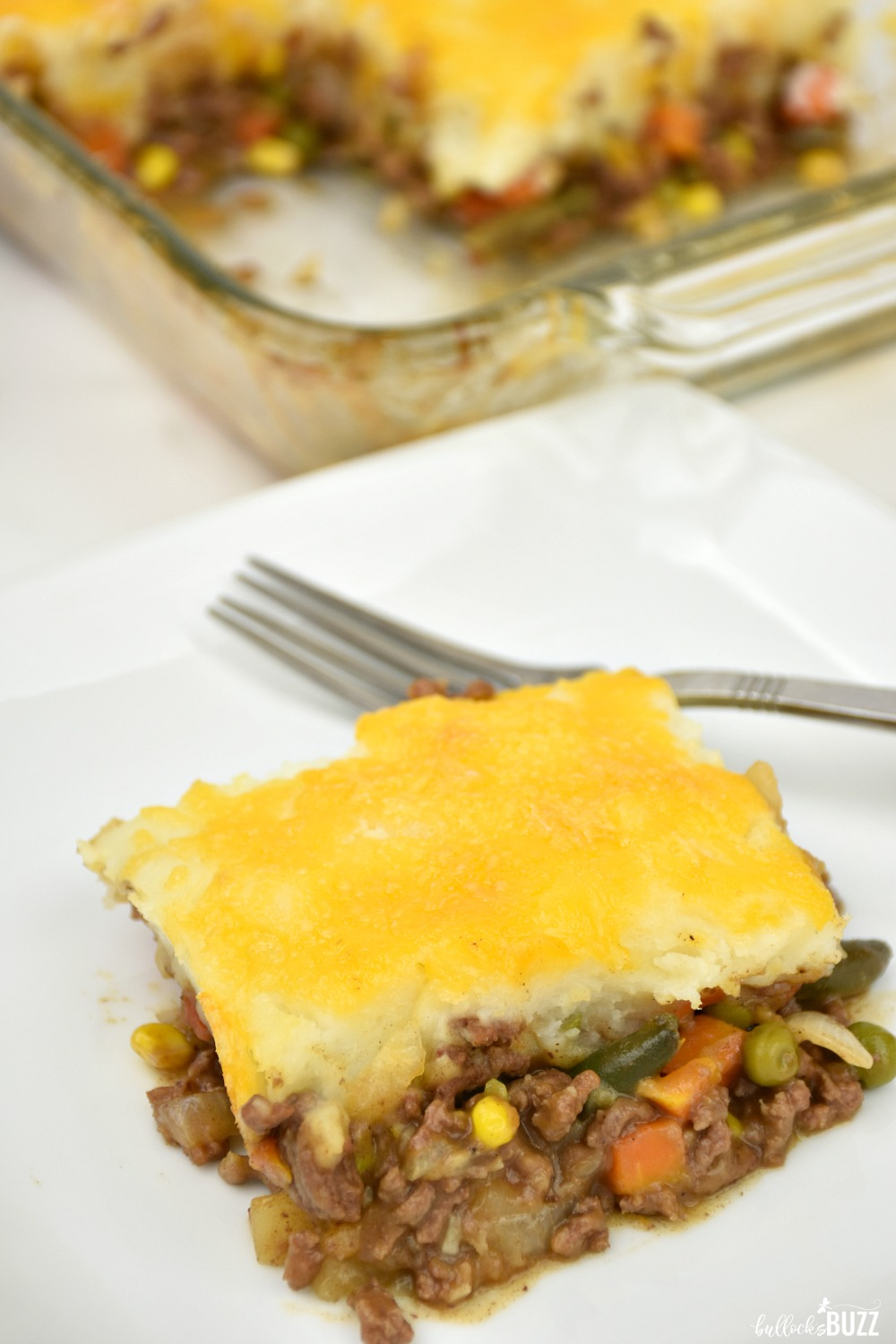 Made with seasoned ground beef, mixed vegetables, fluffy mashed potatoes and cheddar cheese, this classic Shepherd's Pie recipe is quick, easy, and absolutely delicious!