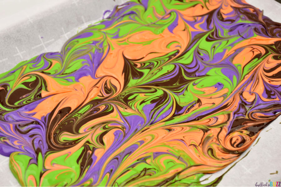 swirled Halloween candy bark on baking sheet