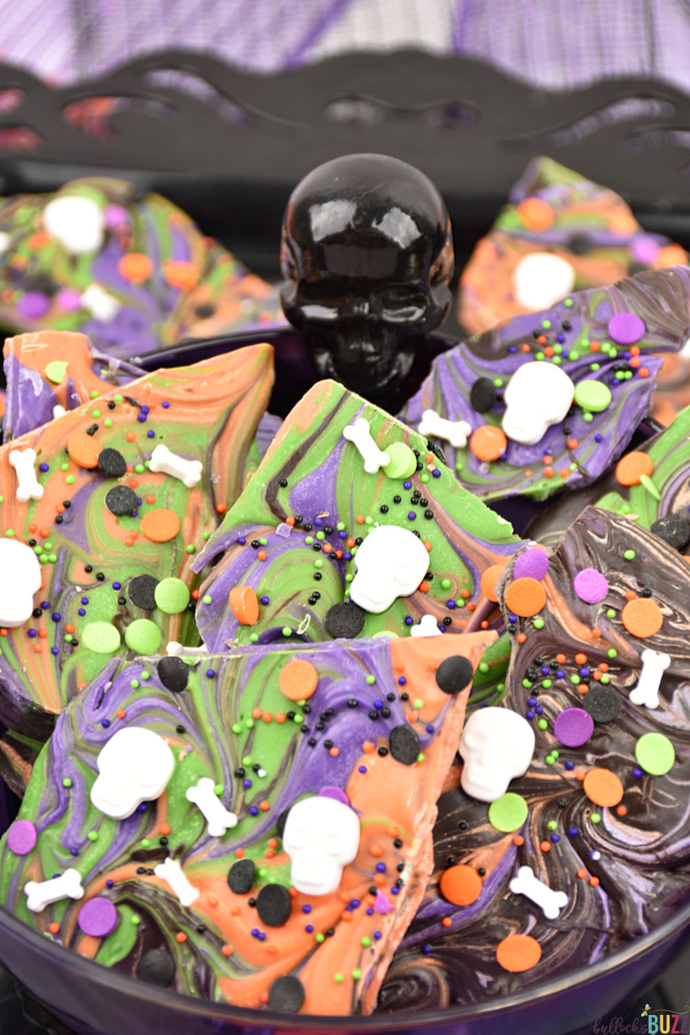 Swirled Halloween Candy Bark in bowl. This easy, no-bake Halloween Candy Bark is a scream! Get the recipe on the Bullock's Buzz blog.
