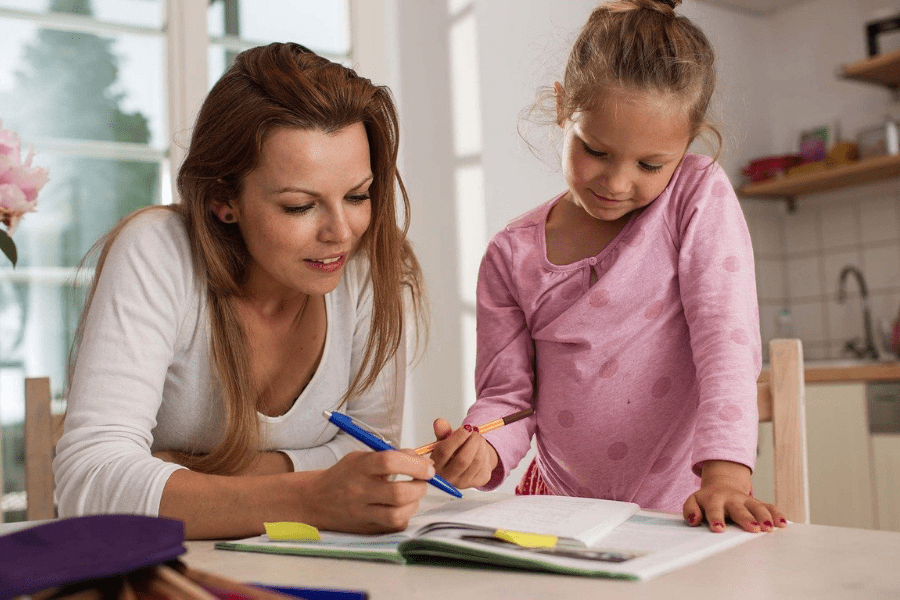 parent helping child with homework is one of the ways to make back-to-school easier