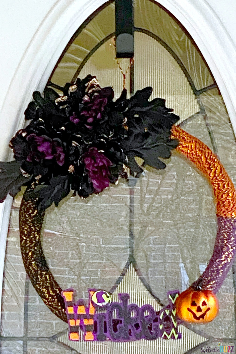 This spooktacular DIY Halloween Wreath idea is almost completely made with supplies from the Dollar Tree and takes less than 30 minutes to make!