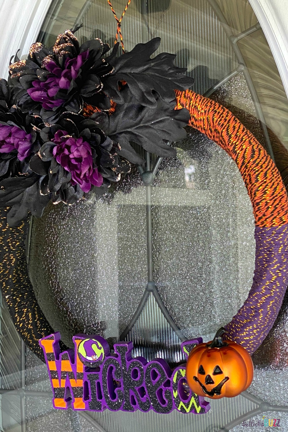 This DIY Halloween Wreath idea is so pretty and cute, your friends will be dying to know where you bought it!