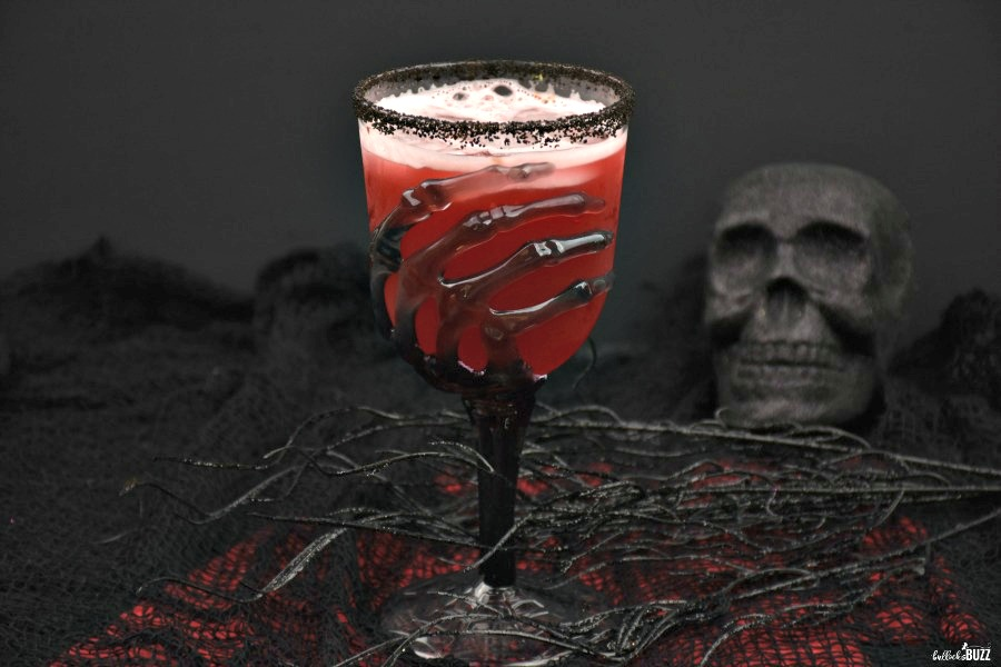 Vampire's Kiss Halloween drink in skeleton hand glass