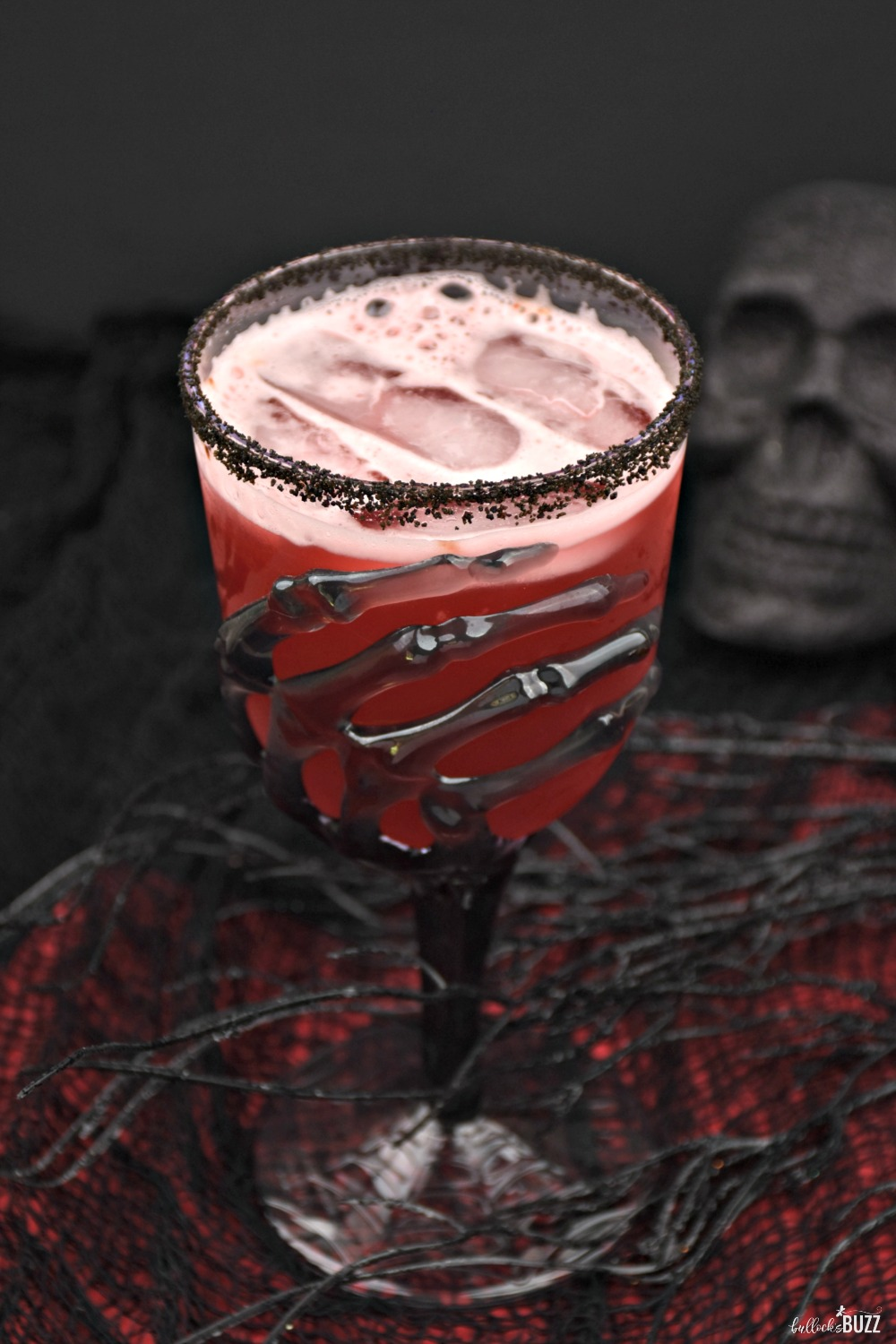 This Vampire's Kiss cocktail is hauntingly easy to make. It requires just a few simple ingredients including cranberry juice, spiced rum, pineapple juice, and a splash of grenadine.