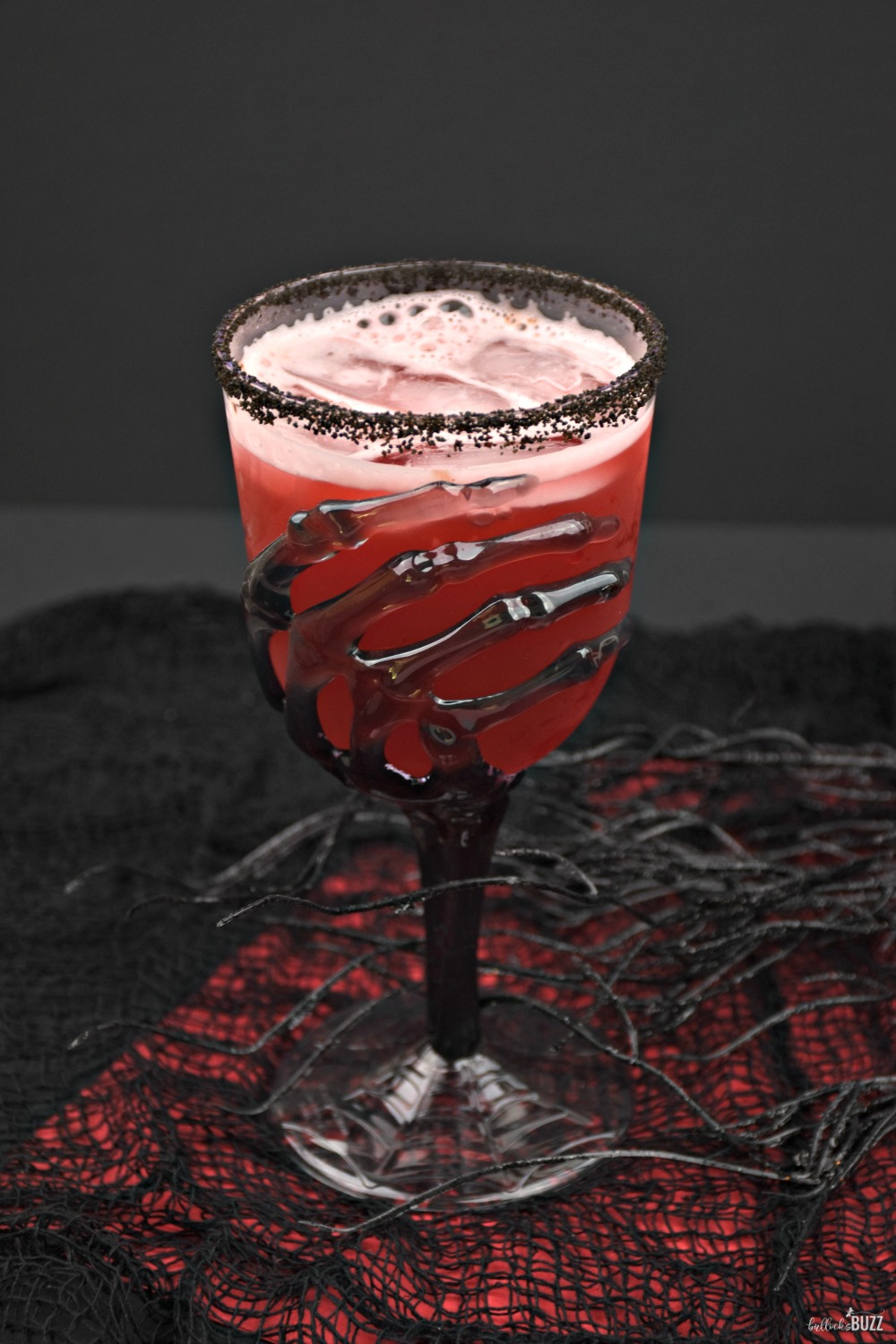 The Vampire's Kiss Halloween cocktail is sure to please both mortals and vampires alike with its fruity taste and spooktacular color!