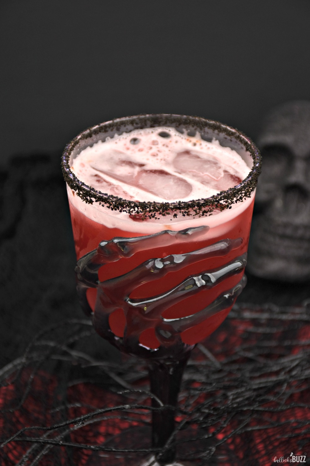 The Vampire's Kiss cocktail is an easy, red Halloween cocktail with a taste good enough to raise the undead!