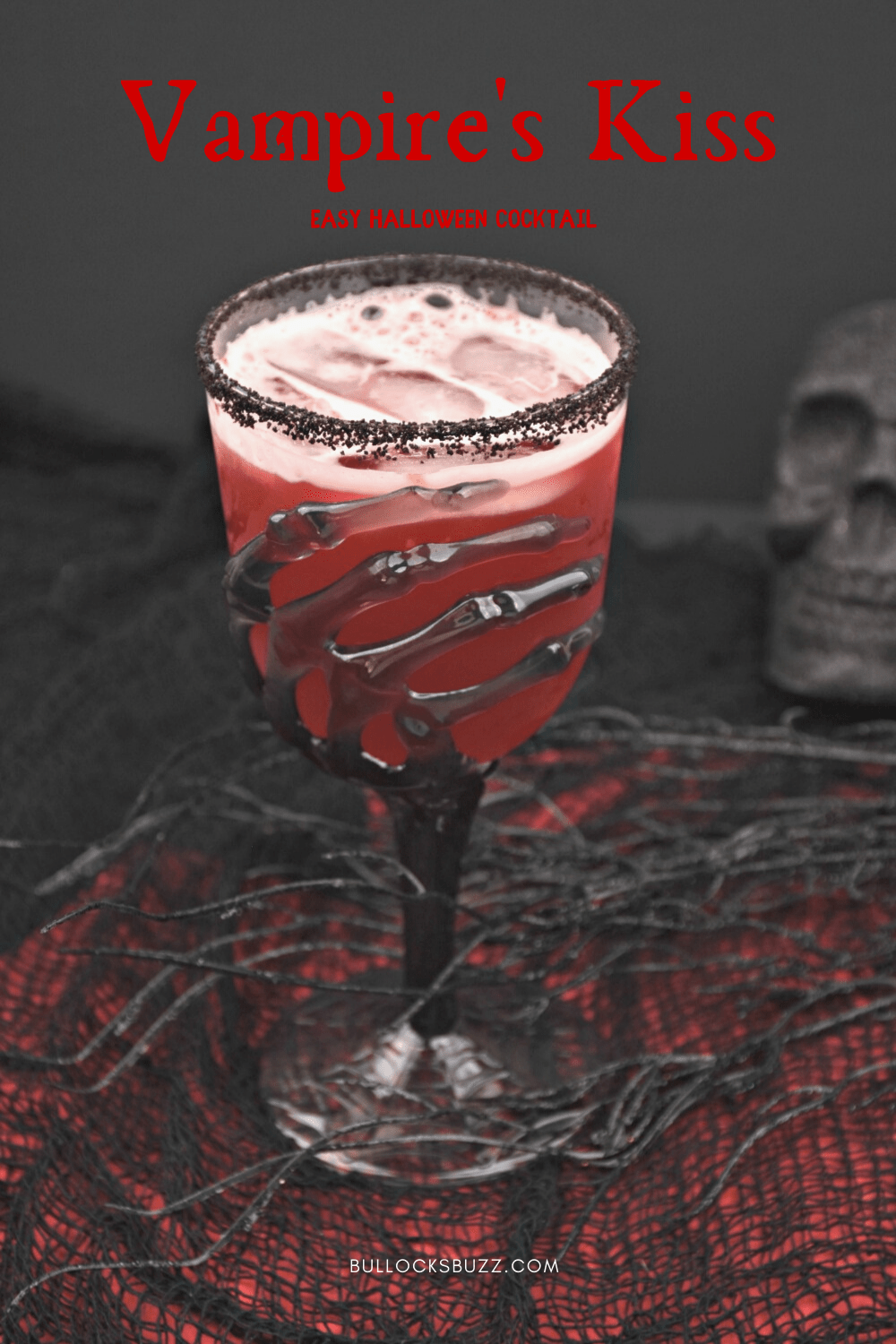 Vampire's Kiss is a fun and easy Halloween cocktail made with crangrape, pineapple juice, grenadine, and spiced rum for a spooky bite. Enjoy sinking your teeth into this Halloween drink! Get the recipe on the Bullock's Buzz blog!