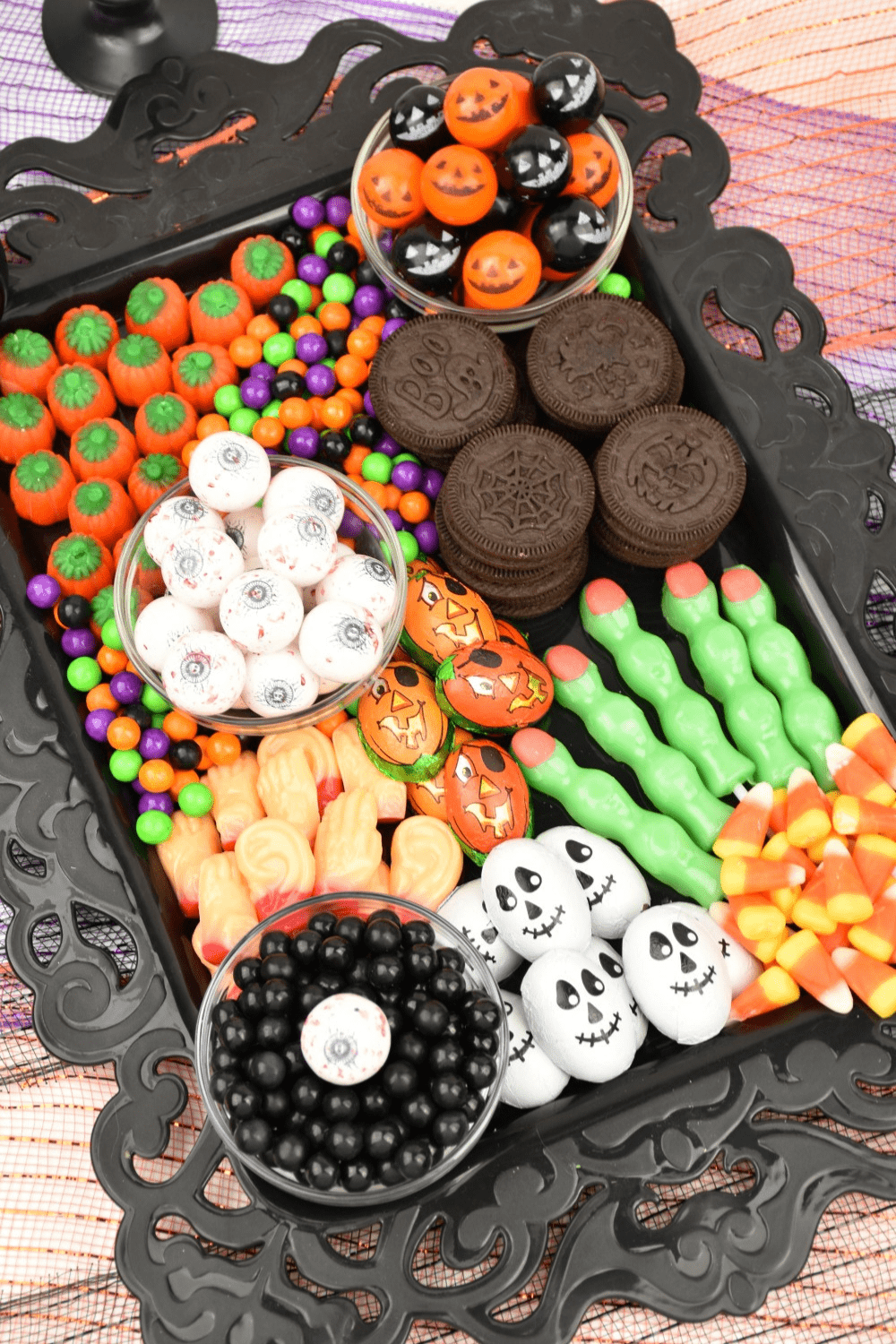 Filled with a delicious selection of traditional Halloween sweets, this chillingly cute Halloween Candy Charcuterie Board is one of my favorite dessert charcuterie boards to make!