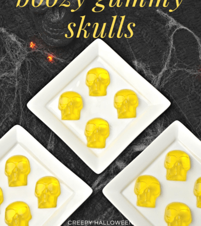 yellow boozy gummy skulls on white plate for Halloween