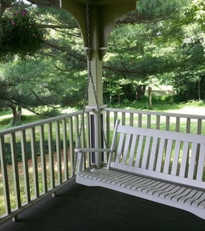 classic swing, one of the many types of porch swings