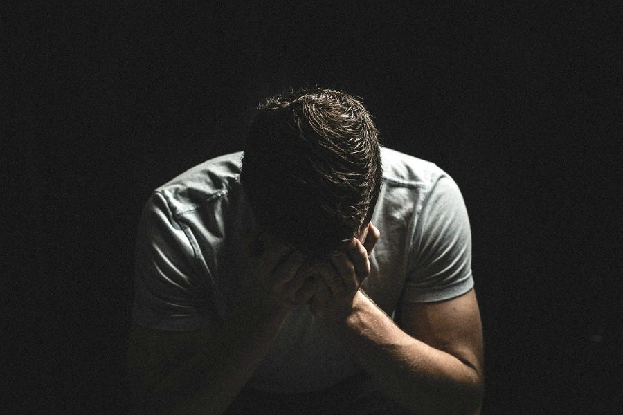 What To Do When A Family Member Dies man grieving
