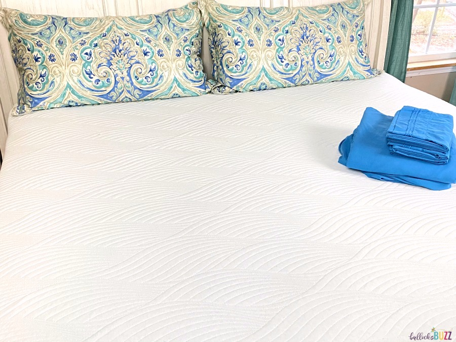 Nest Bedding Cooling Mattress Topper on bed