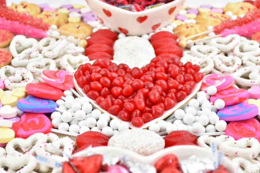 Valentine's Charcuterie Board filled with cookies, candies, and pretzels