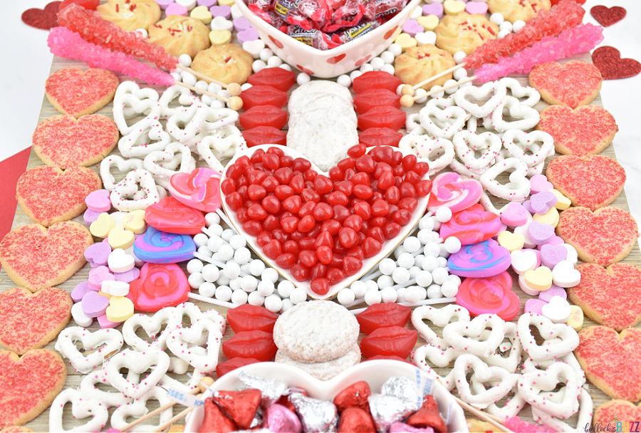 easy Valentine's Day Candy Charcuterie Board with cookies, candies, and more
