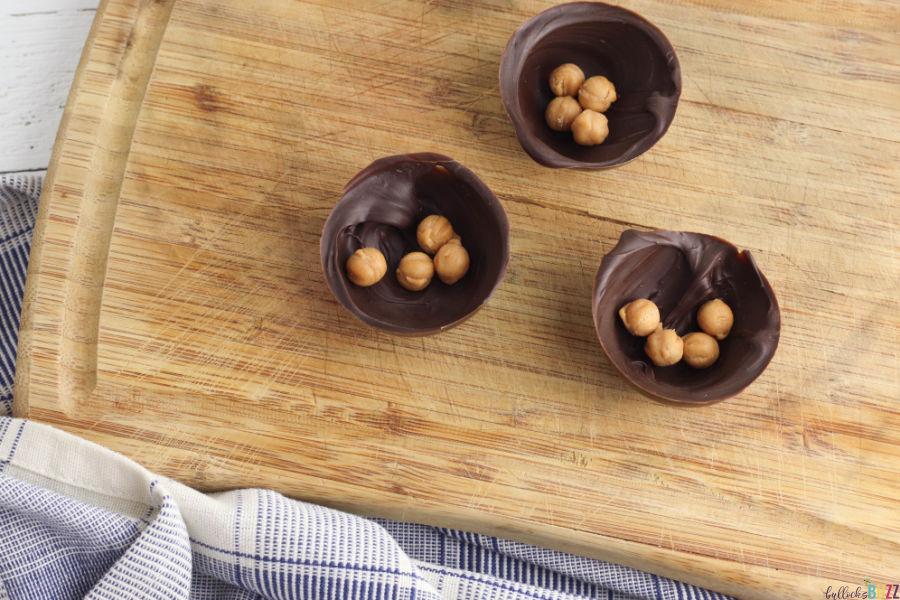 in half of the Caramel Mocha Coffee Bombs half shells add a few caramel bits