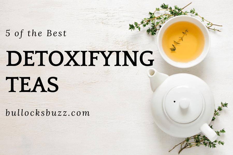 white tea pot and white mug filed with tea