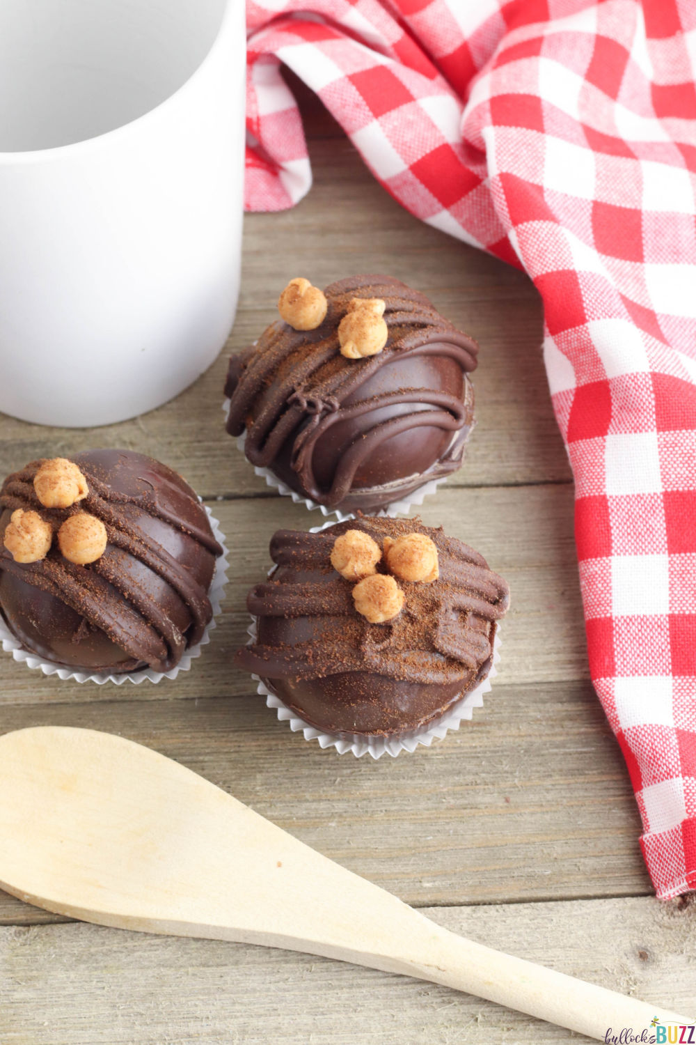 These cold-weather confections are similar to hot cocoa bombs but filled with espresso instead for a mind-blowingly scrumptious cup of caramel mocha coffee. Get this Caramel Mocha Coffee Bomb recipe on the Bullock's Buzz blog! #coffeebomb #espressobomb #recipes #caramelmocha #coffee