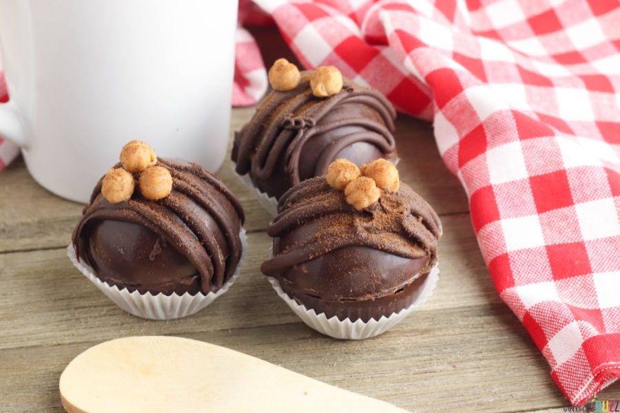 Caramel Mocha Coffee Bombs topped with caramel bits and espresso powder