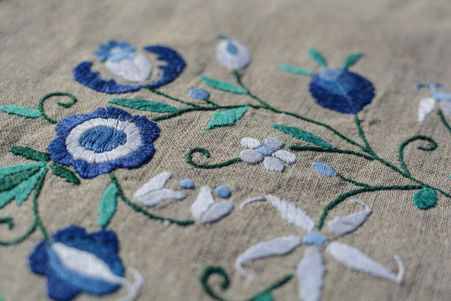 blue floral Embroidery Design on grey fabric