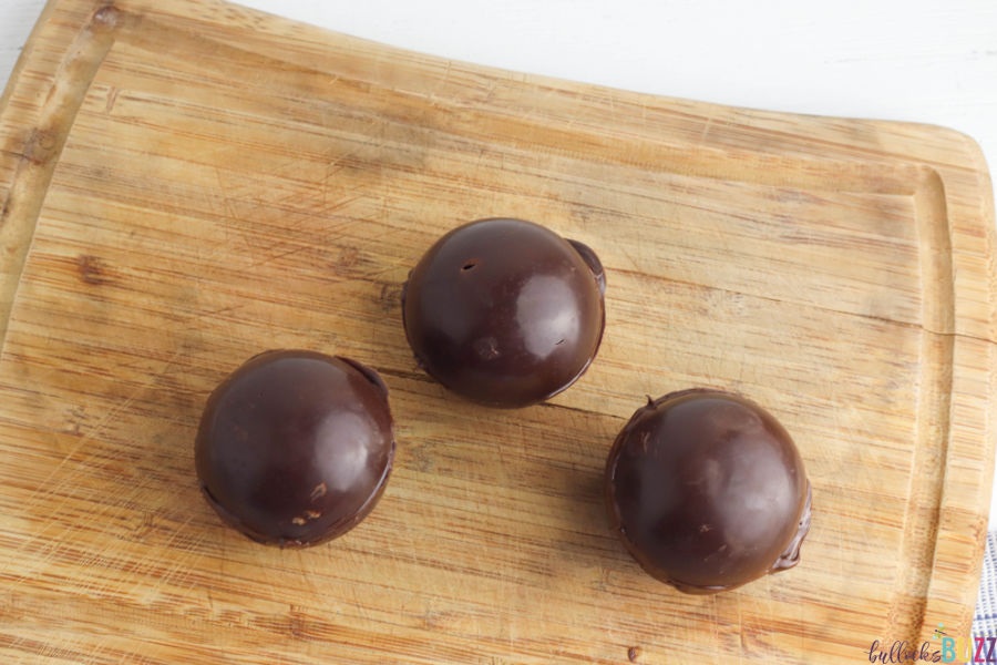 seal the two halves together to make  the Caramel Mocha Coffee Bombs
