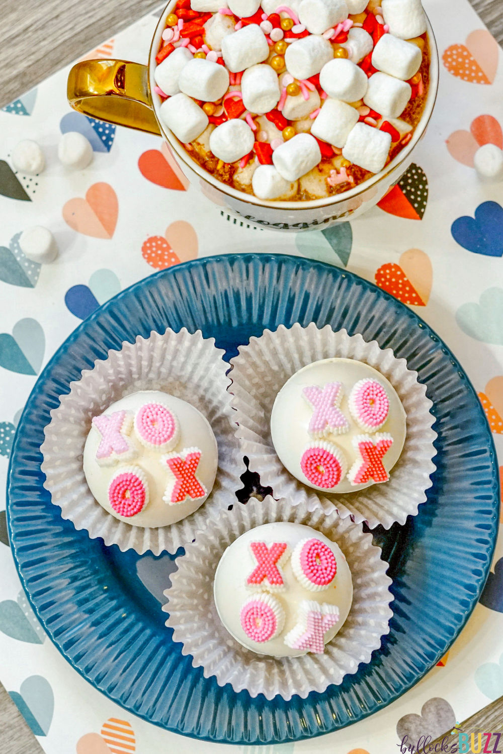 Close up of hot cocoa bombs decorated with XOXO candies.