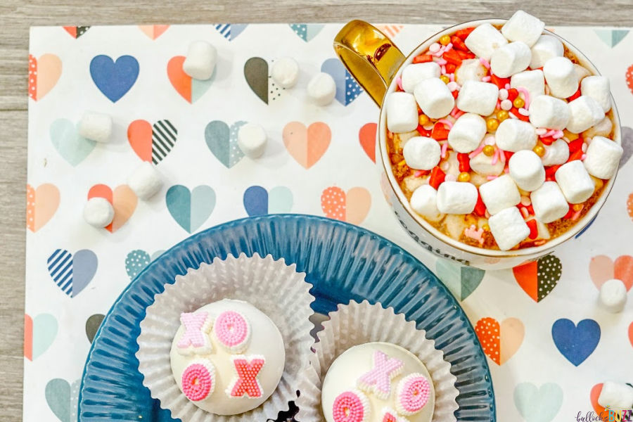 XOXO valentines Hot Cocoa Bombs on blue plate