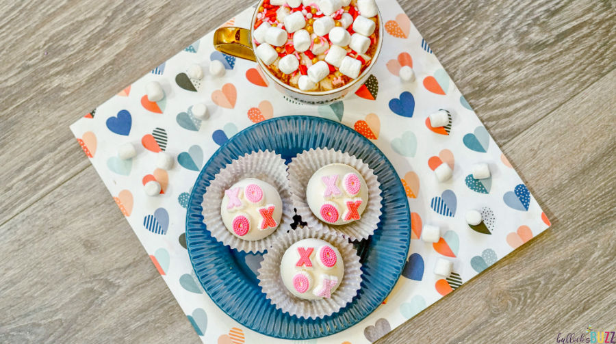 XOXO valentines Hot Cocoa Bombs on plate and in mug