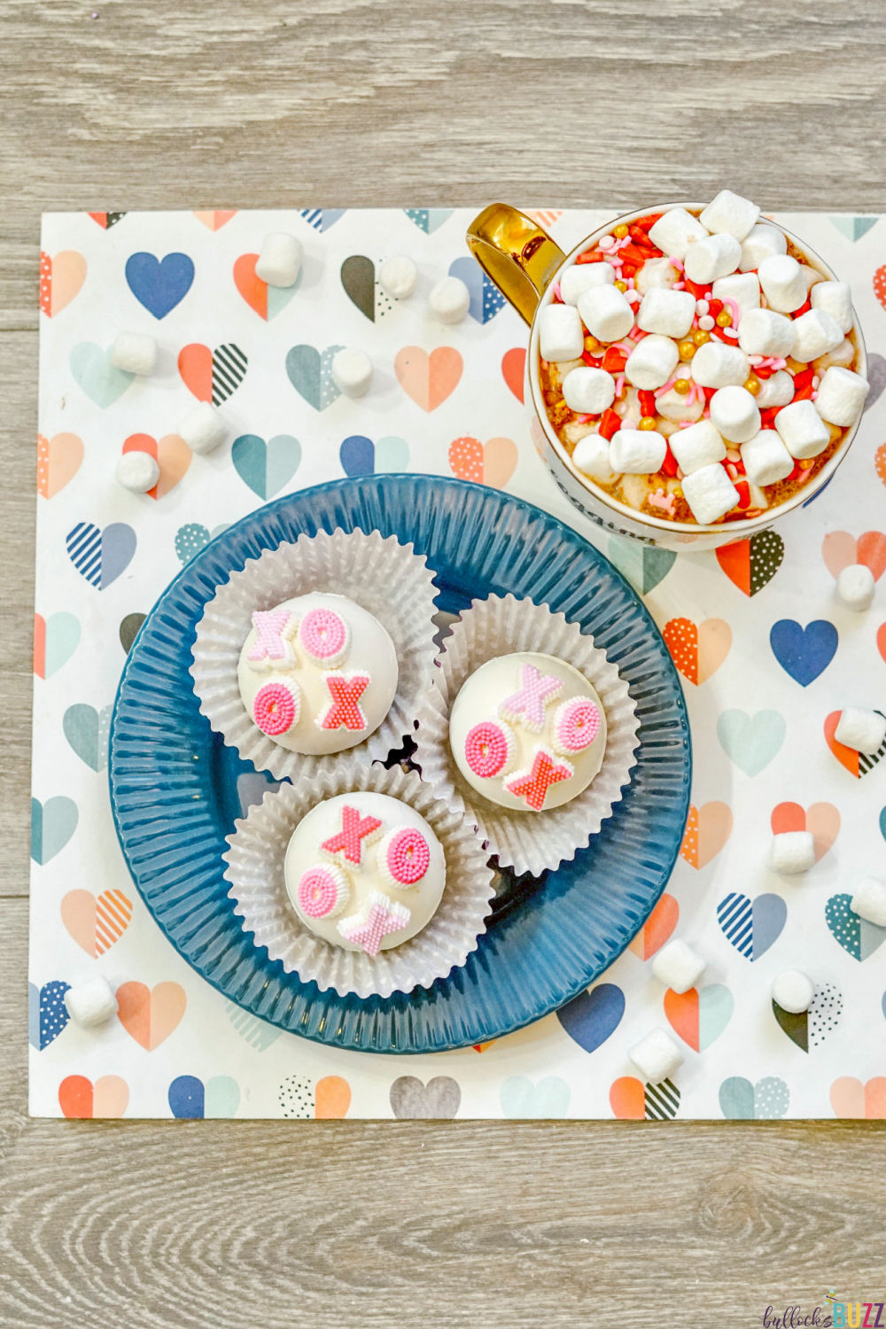 Valentine's Day just wouldn't be Valentine's Day without chocolate. And these delicious XOXO Valentine's hot cocoa bombs are the perfect chocolatey and sweet surprise to give to your special someone!