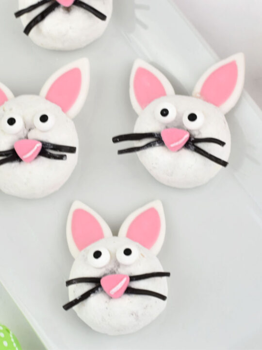 three Easter Bunny Donuts on white platter