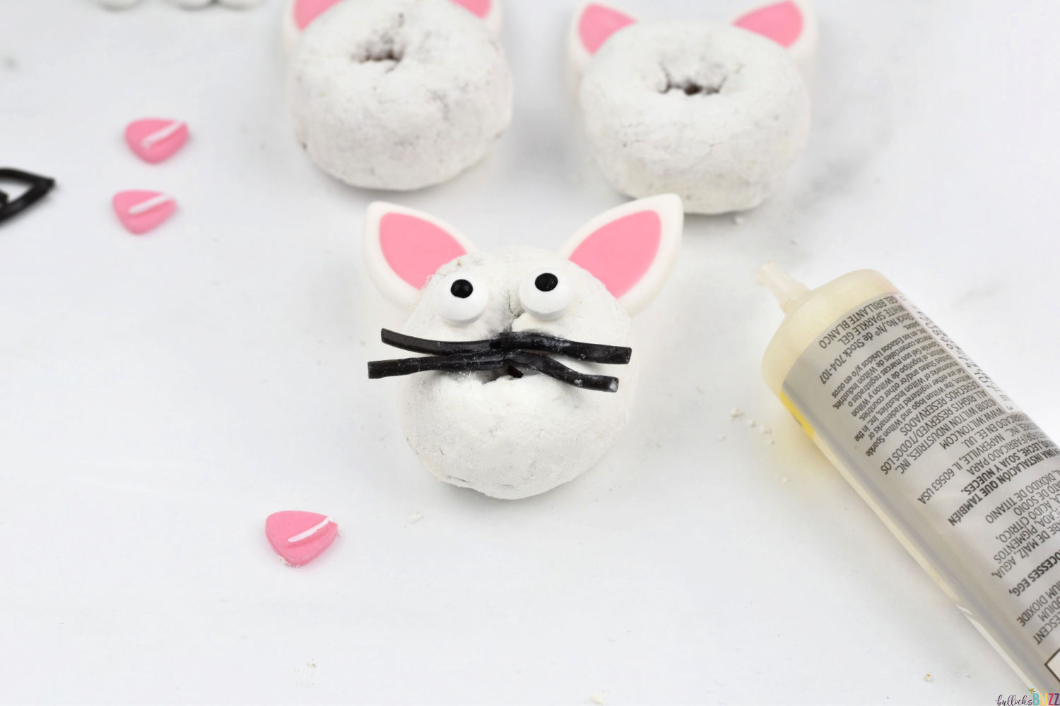 add whiskers to no-bake Easter dessert Easter Bunny Donuts using icing as glue
