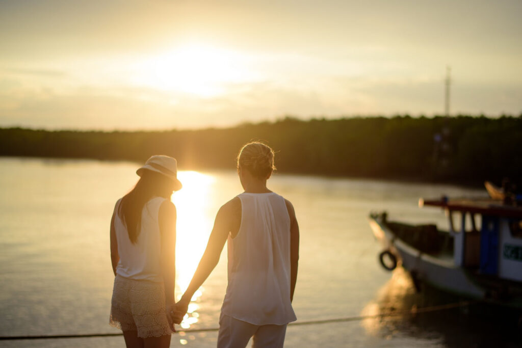 another relationship goal is to talk through disagreements like this couple is while they stand by the water at sunset